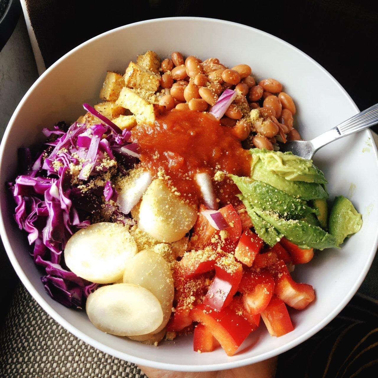 easy bean burrito bowl in a grey plastic bowl.